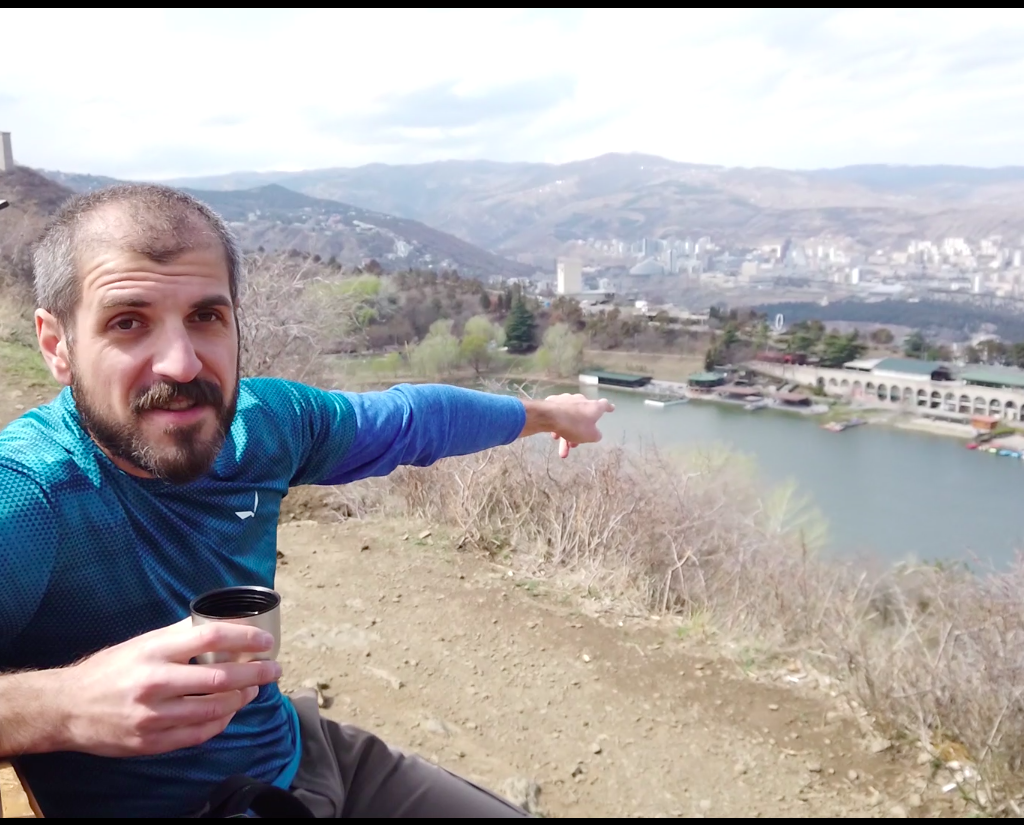 Guide Zviad pointing at Turtle lake in Tbilisi