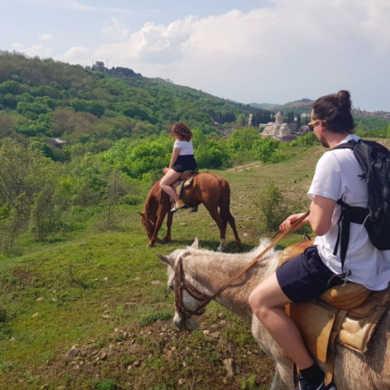 tourists on horses in Georgia