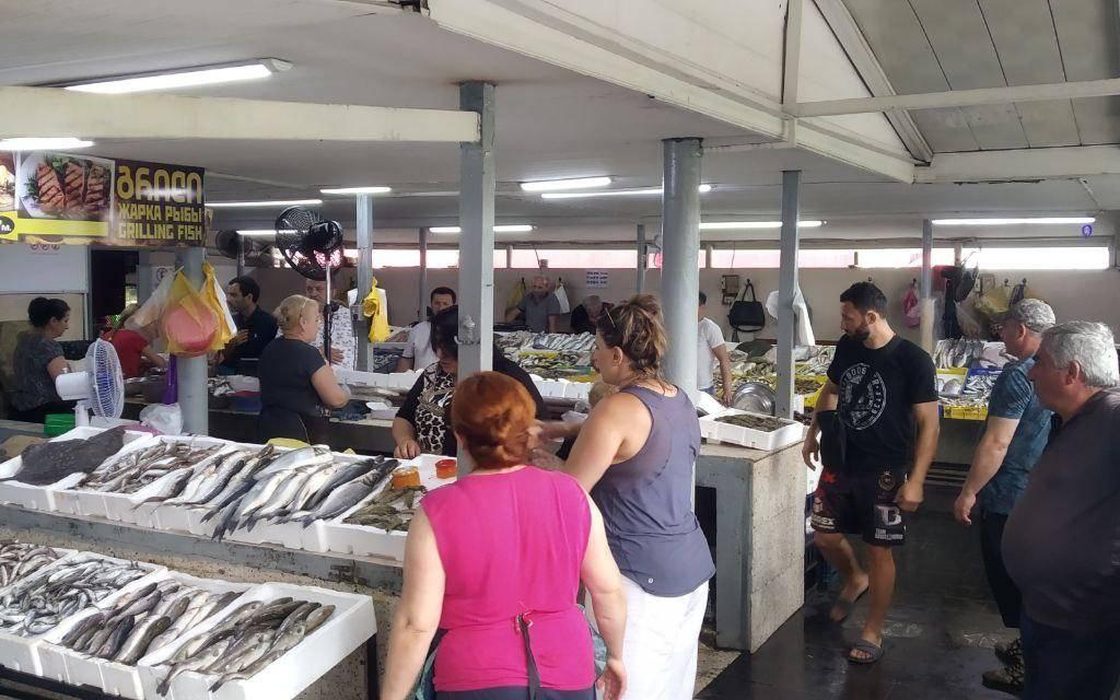 Batumi fish market with sellers and buyers